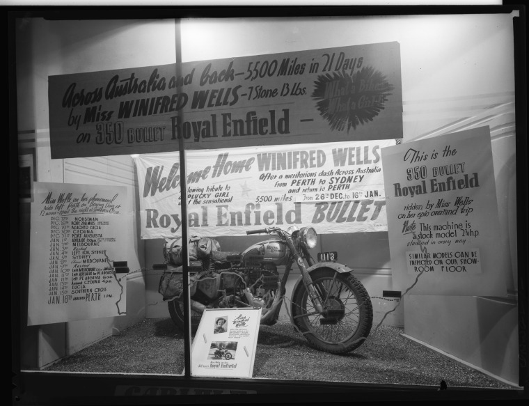 234763PD: Messages or congratulations and the Royal Enfield used by Winifred Wells to travel across Australian and back to Perth, 26 December 1950-16 January 1952 (Click to Start Zoom)