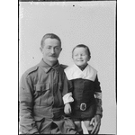 Studio portrait of private McCann and a boy [picture]