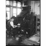 233089PD: Linotype in operation at the Truth newspaper, 1930