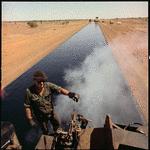326481PD: North West Coastal Highway sealing operations near Winning Pool, February 1970