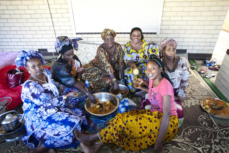 W3R1466: Senegalese Community gathering, 29 September 2012. Women and men eat in separate areas, food is eaten with one hand from a communal bowl (Click to Start Zoom)
