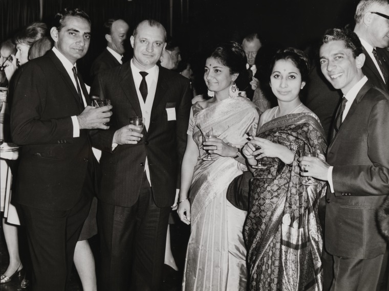 BA1626/79: Manager of Air India (left) with G.G. Merizzi and Air India flight attendants at the W.A. Italian Club, ca.1968 (Click to Start Zoom)